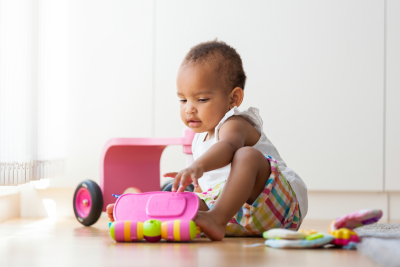 baby playing with her toys